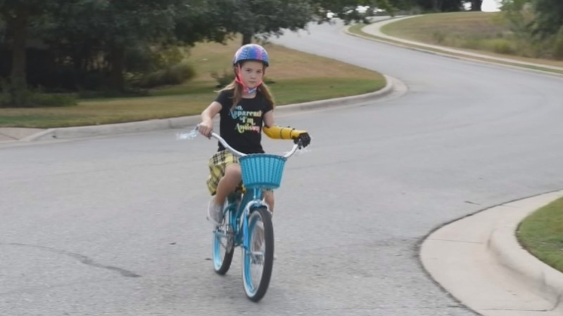 Bionic girl realizes her dream to ride her bike