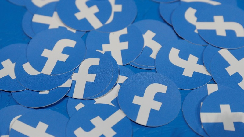 Facebook e-coin presses on despite defections