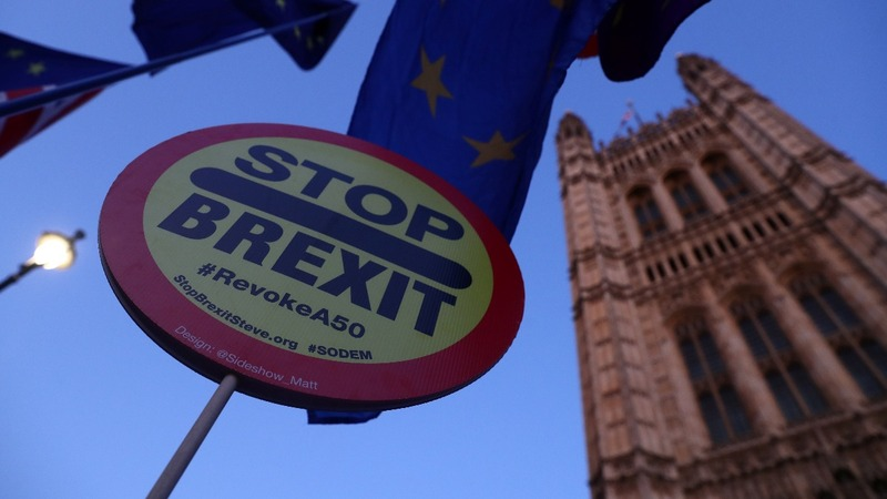 UK lawmakers reject Brexit law timetable