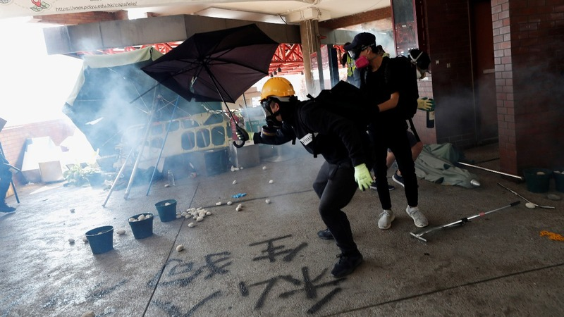 Police open fire at protesters in Hong Kong