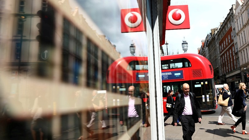 Vodafone lifts outlook as it returns to growth