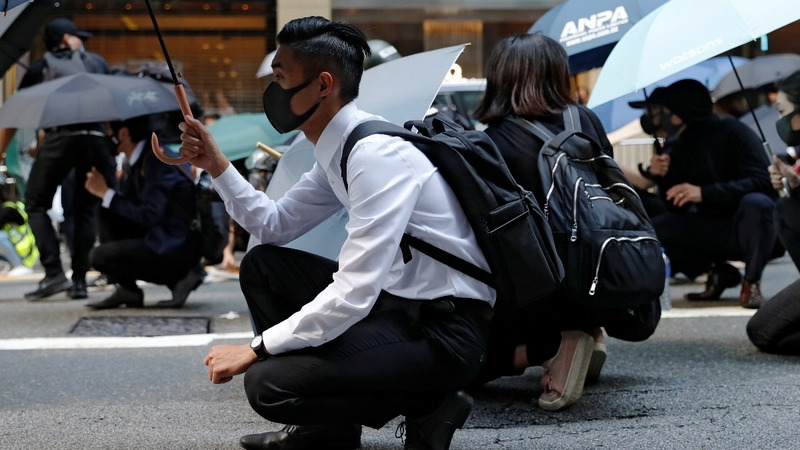Rare weekday protests flare in Hong Kong