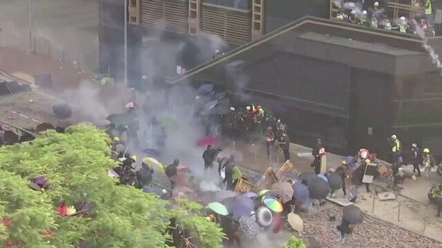 Clashes continue as HK police arrest protesters