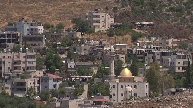 U.S. softens position on Israeli settlements