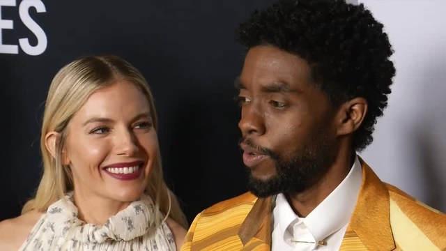 Chadwick Boseman and Sienna Miller celebrate the opening of their new film, '21 Bridges'