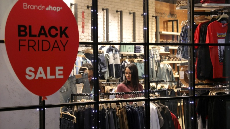 Thinner U.S. crowds but Black Friday goes global