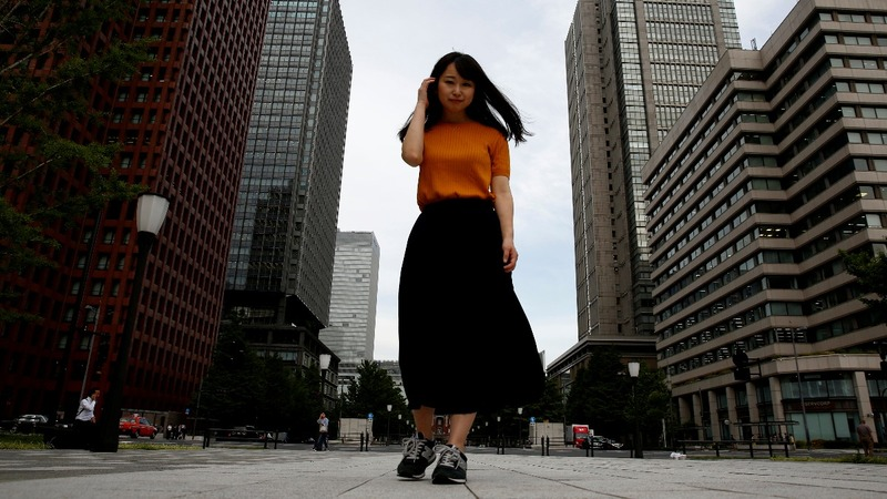 Specs on, heels off: Japan's fight dress code fight