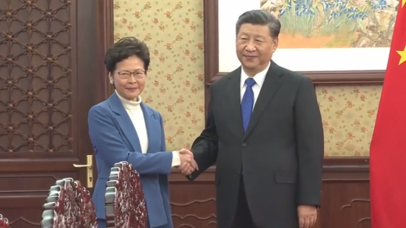 China's Xi vows support for Hong Kong leader